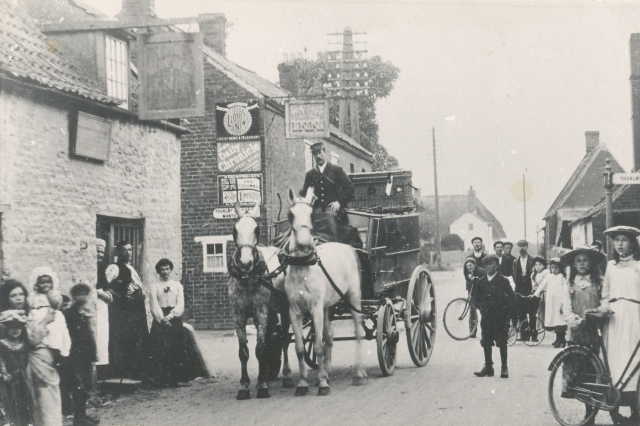 Thurlby Cross Roads. The Bell Inn on the left as built close to the road. The Five Bells with its original front and the Horseshoe. The Royal Mail cart with driver Mr Toulson. C1905/1906