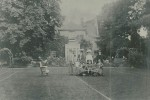 The Old Vicarage, Thurlby. Rev and Mrs Pettifer with friends. On lawn to south. Marked out as tennis court.